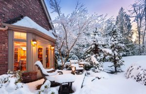 Warm house in the winter snow